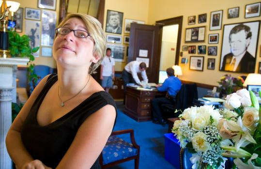 Elyssa Koidin, who lives in Washington, D.C., cried as she looked at pictures in Senator Kennedy's office yesterday. She was an intern for Kennedy in 2003.