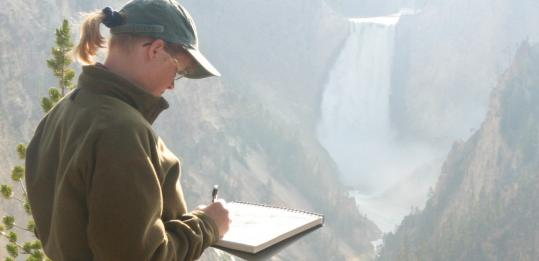 "Lita Judge, seen working on a drawing for her children's book, ""Yellowstone Moran,'' will visit Newton on Saturday."