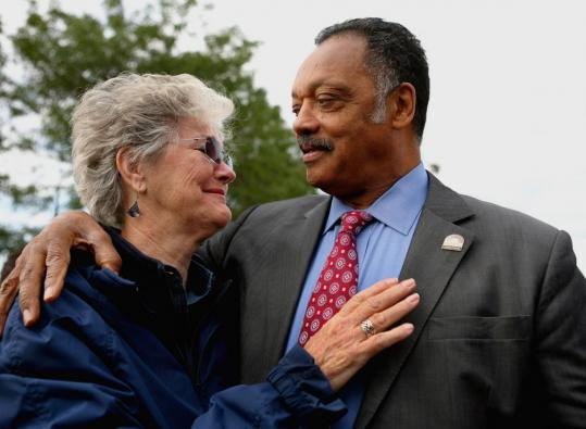 Polly Musch of Santa Ana, Calif., greeted the Rev. Jesse Jackson as she waited to pay her respects yesterday at the John Fitzgerald Presidential Library and Museum.