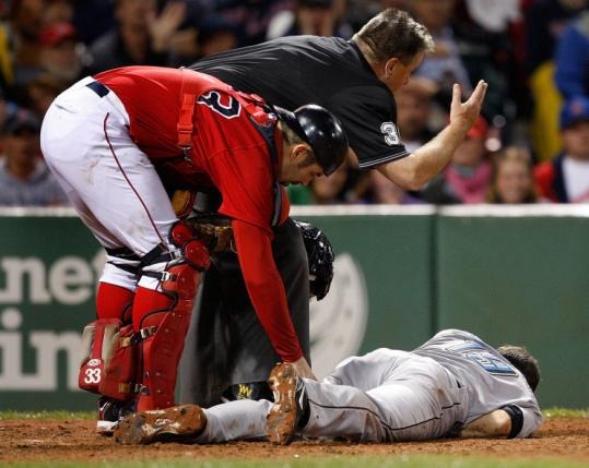 Jason Varitek checks Blue Jays shortstop Marco Scutaro after he was hit in the head by a Josh Beckett pitch in the fourth.