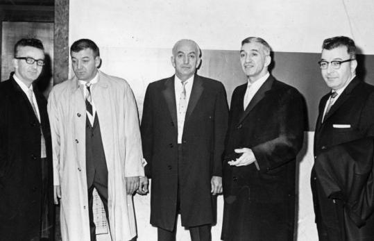 Five of the six Angiulo brothers in 1961 at Suffolk County Courthouse, where they appeared before a special grand jury probing the Massachusetts Turnpike Authority. From left, Antonio, Michele, Nocolo, Gennaro, and Donato. At right, Gennaro Angiulo as he was taken from federal court after a jury found him guilty of racketeering charges.