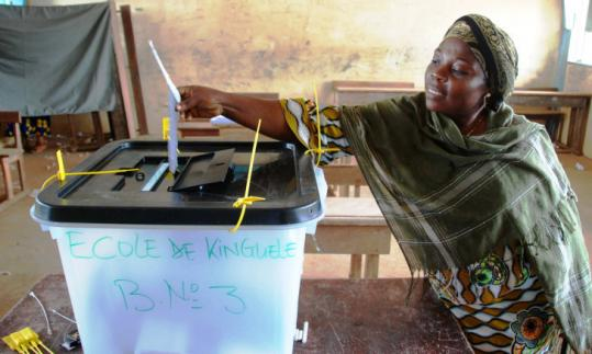 A woman cast her vote for president yesterday at a polling station in Libreville, Gabon, where turnout was heavy.