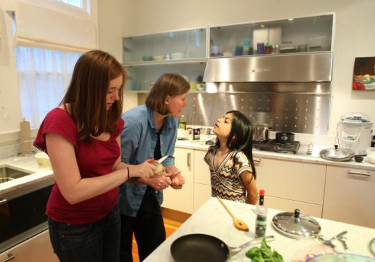 Lisa Landsverk and her daughters Rachael (left) and Teymura are among the new inhabitants of Julia Child's former house.