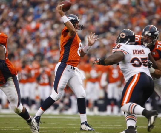 New Broncos quarterback Kyle Orton, who later left the game with an injured finger, delivers a completion against the Bears.