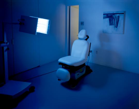 "Like many of the images in Cara Phillips's show at Suffolk University Art Gallery, ""Blue Laser Consultation Chair, New York City'' looks like the setting for a ritual."