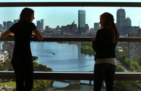 Samantha Barbosa (left) and Rina Beyda have a commanding view from the 25th floor of the apartment-style dorm at BU.