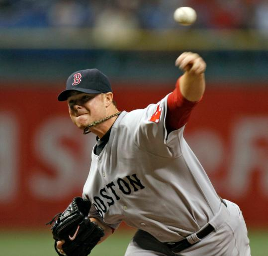Red Sox starter Jon Lester delivers to the Rays in the first inning. He gave up two runs in six innings, striking out nine.