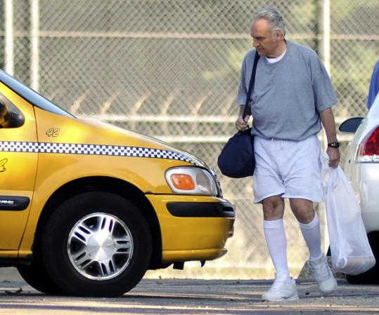 James Traficant, former Ohio congressman, headed for a cab yesterday after his release from federal prison in Rochester, Minn.