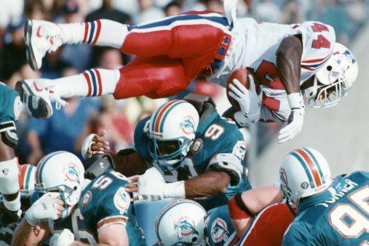 John Stephens, diving over the Miami Dolphins. He led the Patriots in rushing for three seasons.