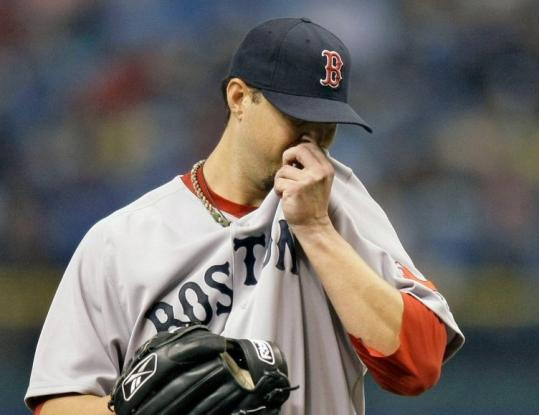 Red Sox starter Josh Beckett wishes he could wipe away the second inning, in which he allowed three runs on four hits.