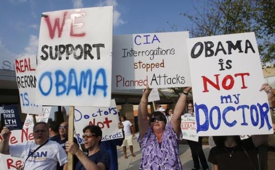 Demonstrators for and against President Obama's health care proposals rallied before the start of a town hall-style meeting last month at South Lakes High School in Reston, Va.