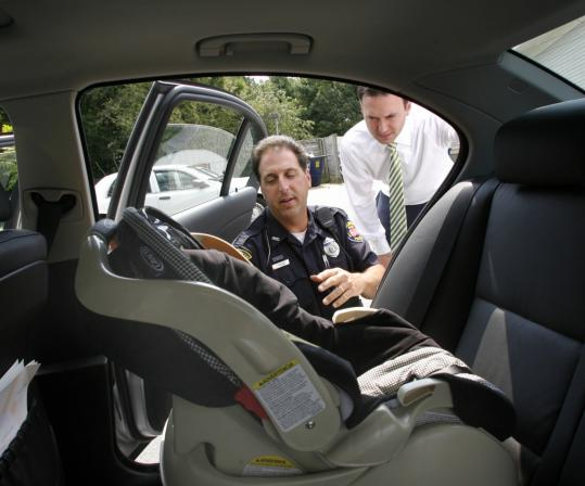 Burlington Police Officer Bernie Schipelliti Sets Up A Car Seat For Father To Be
