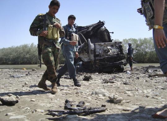 Afghan police investigated the wreckage of the hijacked fuel tankers targeted in the airstrike yesterday. The strike killed more than 70 people, most of them civilians, according to police.