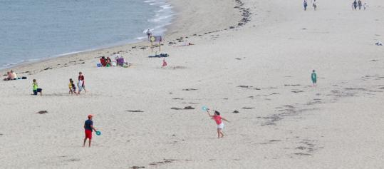 Beachgoers enjoyed Lighthouse Beach in Chatham yesterday before the Labor Day weekend.