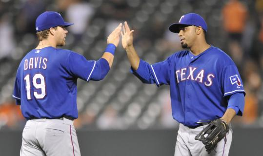 The Rangers' Nelson Cruz (right), who hit his 31st home run, celebrates with Chris Davis after Texas beat the Orioles for its fourth straight win.