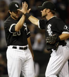 Carlos Quentin congratulates Mark Kotsay (right) for a big game against his former team.