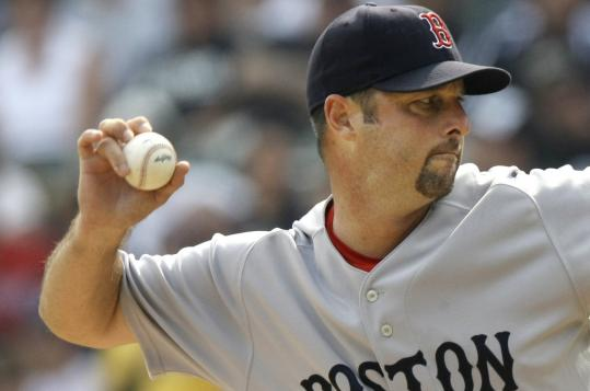 Tim Wakefield tosses a knuckleball in the first inning. He went 6 innings, allowing 4 runs on 6 hits, walking 3 and fanning 4.