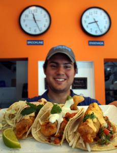 DORADO TACOS & CEMITAS, BROOKLINEAlberto Mendez with a platter of the restaurant's Ensenada, Dorado, and Asiatico fish tacos.