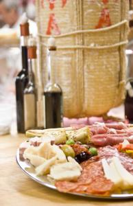 At Salumeria Italiana in the North End, an antipasto platter includes sliced cured meats, cheeses, olives, marinated vegetables, and other savory delicacies.