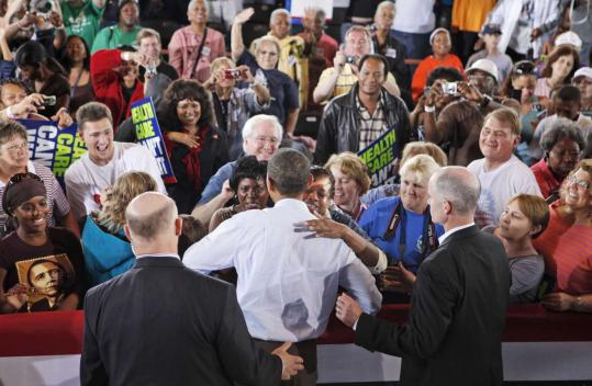 President Obama was embraced as he greeted union workers and their families at an AFL-CIO picnic in Cincinnati yesterday.