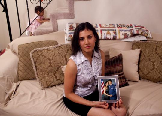 Ana Vongphakdy holds a photo of her w