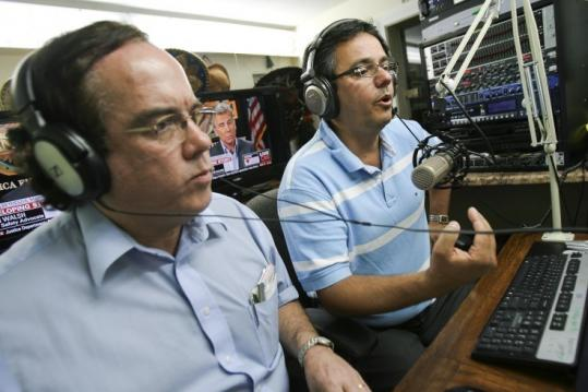 On the radio in Quincy, Jose Bravo (left) and Fausto da Rocha urged illegal immigrants to boycott the 2010 Census.