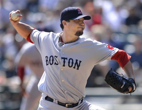 Red Sox starting pitcher Josh Beckett delivers a pitch against the Chicago White Sox in the first inning. Beckett gave up three earned runs on six hits over seven innings. Stroll through our gallery for more scenes from Monday's game.