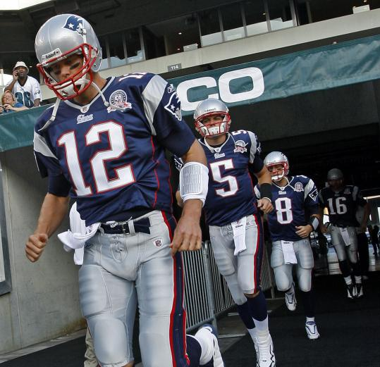 Tom Brady recovered from a 2008 knee injury (above) and was in a familiar role in the preseason - leader of the Patriots.