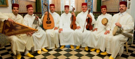 The Orchestra of Tetouan among them play Andalusian music on violin, viola, rebab, lute, tambourine, goblet drum, and zither.