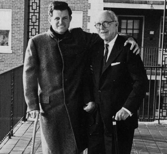 Ted Kennedy, injured in a plane carsh, greets his father Joseph outside a Boston hospital in 1964.