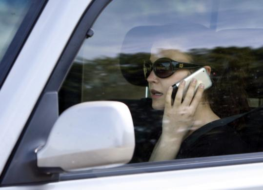 Maine's new law defines distracted as being engaged in an activity not necessary to the operation of the vehicle.