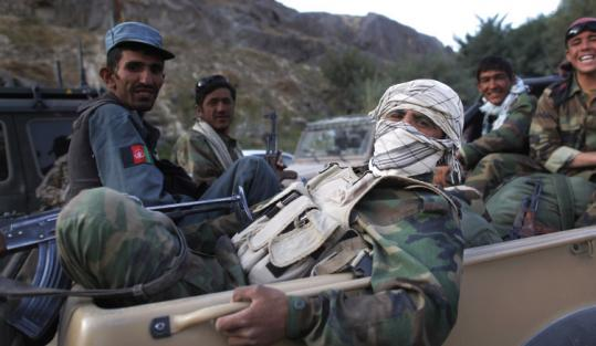 Afghan Army soldiers and police officers patrolled by pickup truck near Kunduz yesterday.