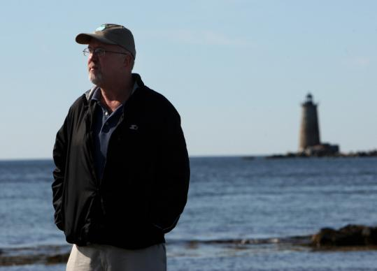 "Jeremy D'Entremont, shown near Whaleback Light in Kittery Point, Maine, said selling a lighthouse to private owners is ""a bit of a roll of the dice.''"