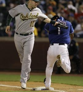 Oakland first baseman Daric Barton tags out the Rangers' Elvis Andrus on a groundout to short on a night Texas would like to forget.