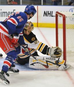 Tuukka Rask (31 saves) denies the Rangers' Matt Maccarone in the Bruins' 2-1 exhibition win.