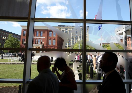Crowds gathered inside and out for the opening of the US Citizenship and Immigration Services office in Lawrence yesterday.