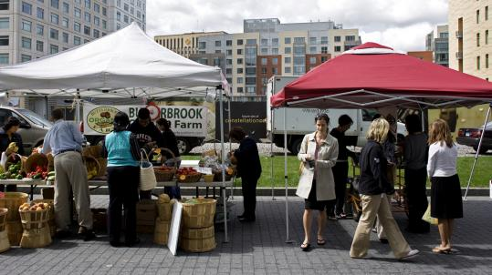 Kendall Square has developed into a vibrant neighborhood with a farmers market, where people shopped recently.