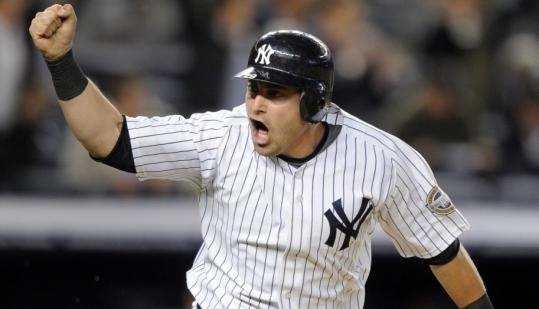 Francisco Cervelli celebrates after his ninth-inning single drives in the winning run in the Yankees' comeback victory over the Blue Jays in New York.