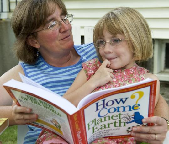 Maynard resident Linde Ghere with her daughter, Aurora, 6, a first-grader who reads at a fifth-grade level.
