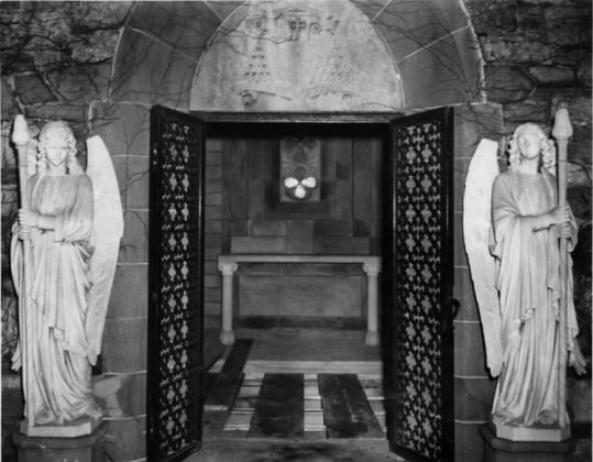 A photo taken in 1944 showed the gothic crypt at St. John's Seminary where the cardinal's remains were to rest, including an altar for Masses, boards covering the crypt where the casket was to be lowered, and guardian angels flanking the doors.