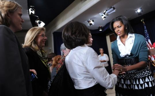 Michelle Obama shook hands yesterday after her presentation sponsored by the White House Council on Women and Girls.
