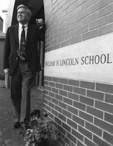 Superintendant James Walsh was photographed at the entrance to the Lincoln School in Brookline after it opened.