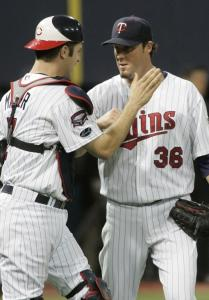 Reliever Joe Nathan (right) and Joe Mauer congratulate each other after Minnesota got within three games of the AL Central lead.