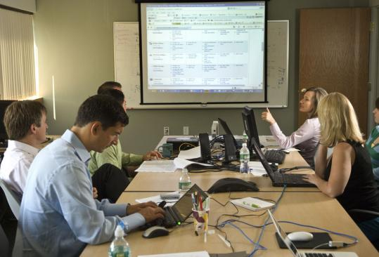 Kayak.com's headquarters are in Norwalk, Conn., but its technology team (above) is located in Concord. The technology team doubled in size this year. The company has been visited by investment bankers interested in taking it public.