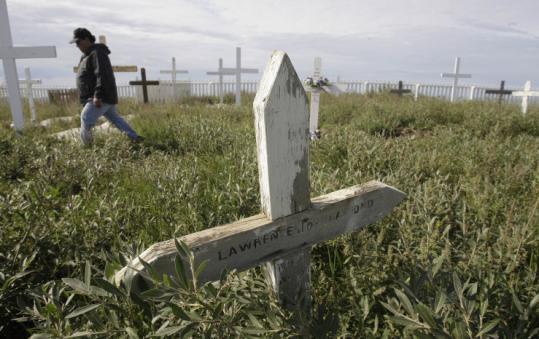 Gus Gruben walked through the cemetery above the beach in Tuktoyaktuk, where tilted crosses reveal a sinking permafrost.
