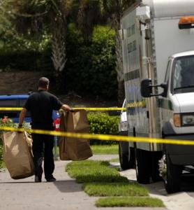 A Collier County crime scene investigator removed bags of evidence yesterday from a home where authorities say Guerline Damas and her five children were found dead.