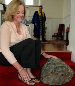 Selectwoman Nancy Hyde, a member of the First Parish of Westwood, with a piece of the rock that emerged from the sanctuary floor after a circa-1900 lightning strike.