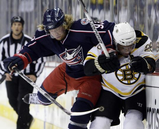 Columbus's Jakub Voracek (left) crashes into Boston's Mark Recchi in exhibition play last night.