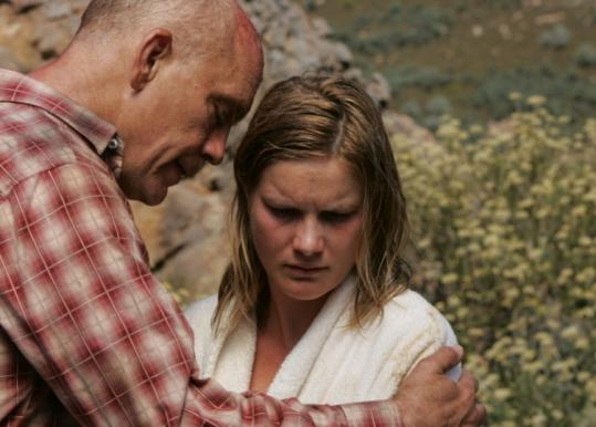 "John Malkovich and Jessica Haines costar in ""Disgrace.''"