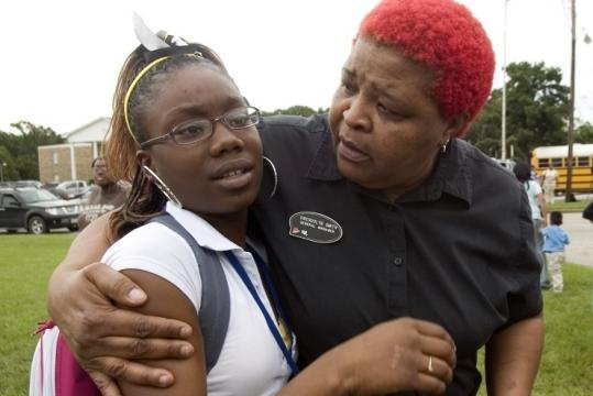 Da'kia Allen, a ninth-grader at John Tyler High School, was hugged by her aunt Gwen Smith after students were released.
